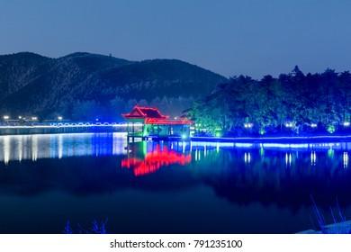 night view of mount lushan, traditional pavilion on lake, China