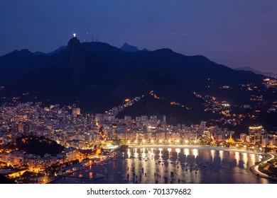 Night view of mountain Sugar Loaf and Botafogo in Rio de Janeiro.