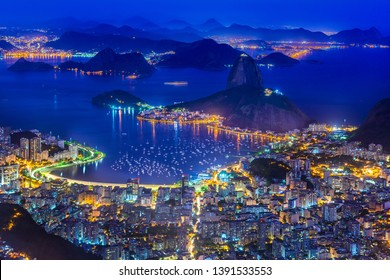 Night view of mountain Sugarloaf and Botafogo in Rio de Janeiro, Brazil. Sugarloaf is one of the main landmark of Rio de Janeiro. Skyline of Rio de Janeiro