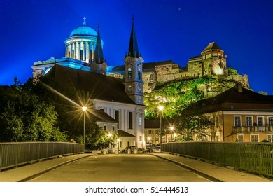 Night view of a narrow street in the hungarian city Esztergom with the church of saint Ignac and basilica on top of the hill.