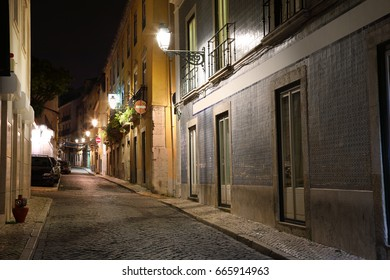Night view of the narrow streets of old Lisbon, Portugal