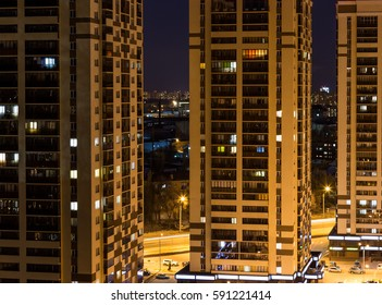 Night view of new modern skyscrapers in yellow tones, new business centres or living apartments in Voronezh city