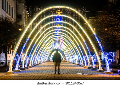 Night view of New Year or Christmas decorative arches with bright lights during winter holidays in Ivano-Frankivsk city, Ukraine.