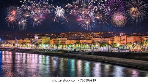 Night view of Nice with fireworks on the black sky, Cote d'Azur, French Riviera, France