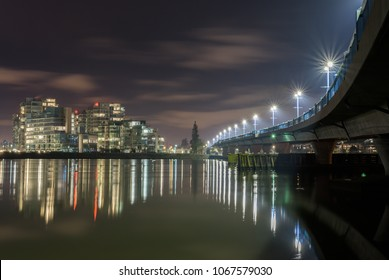 A night view of No 2 Road Bridge and several apartment buildings in Richmond, British Columbia.
