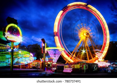 Night view at Odessa ferriswheel. Evening in Odessa city. Entertainment in park Shevchenko and its attractions.