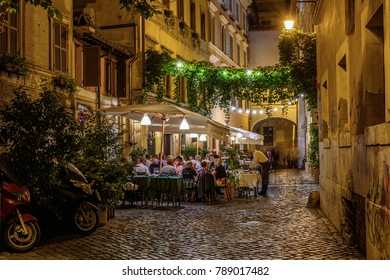 Night view of old cozy street in Trastevere in Rome, Italy.  Trastevere is rione of Rome, on the west bank of the Tiber in Rome, Lazio, Italy.  Architecture and landmark of Rome