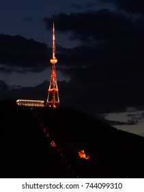 The night view of the old district of Tbilisi capital of Georgia, with Tbilisi broadcasting tower / The night view of the old district of Tbilisi
