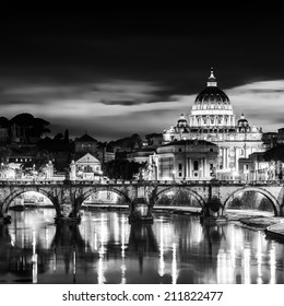 Night view of old roman Bridge of Hadrian and St. Peter's cathedral in Vatican City Rome Italy.