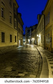Night view of the old street in the center of Prague near Charles Bridge - Czech Republic