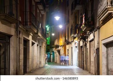 night view of old  street of european city.  Girona, Catalonia