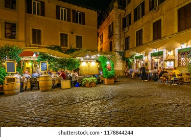 Night view of old street in Trastevere in Rome, Italy. Trastevere is rione of Rome, on the west bank of the Tiber in Rome, Lazio, Italy.  Architecture and landmark of Rome
