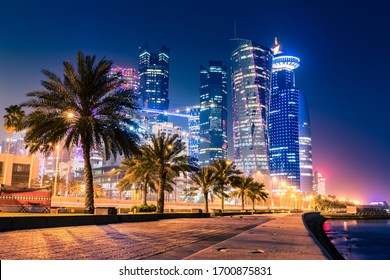 Night view on the centre of the city Doha, Qatar with many modern luxury building and skyscrapers illuminated with numerous lights.