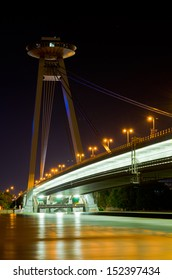Night view on lighted SNP bridge over Danube in Bratislava with 2013 river flood.