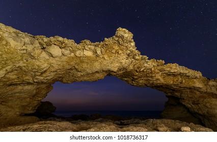 Night view on natural stones bridge with Ursa Major and North star  , Portinatx , Ibiza .