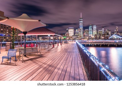 Night view on pier in Jersey city and Manhattan