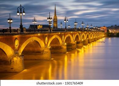 Night view on The Pont de pierre crossing Garonne river, Bordeaux.