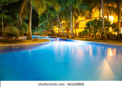Night view on pool in tropical environment