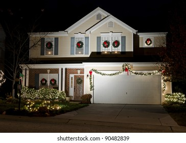 Night view on residential house exterior decorated and lighted for Christmas holidays
