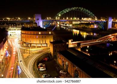 Night view on the streets, Tyne bridge and Tyne dock, crossroad between buildings, shining traffic lines, reflection on the river, Gateshead, Newcastle upon Tyne, United Kingdom UK