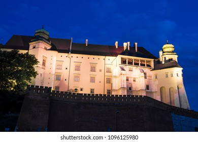 night view on Wawel Royal Castle in old historical European  town of Poland - Krakow, amazing twilight cityscape, defensive fortifications and towers, famous landmark of  architecture Europe