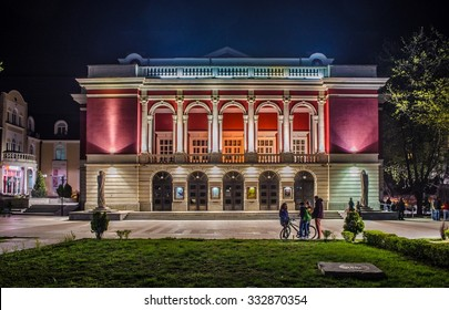 night view over building of bulgarian national opera house in rousse - ruse.