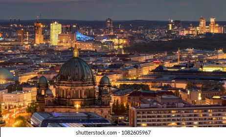 Night view over Germany's capital Berlin with the Berliners Dom in front.