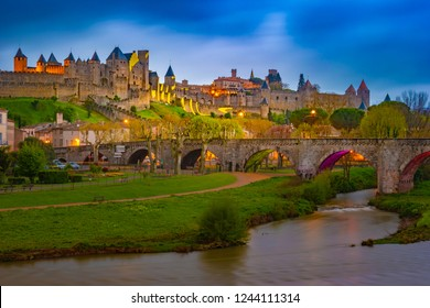 Night view over illuminated fortification of Carcassonne, France. Famous medieval city with beautiful night illumination.