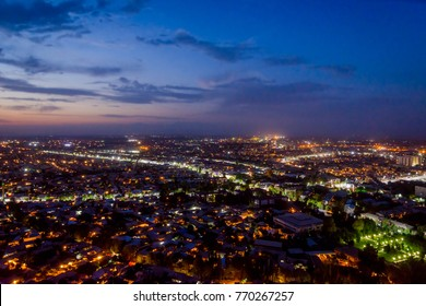 Night view over illuminated Osh town, Kyrgyzstan