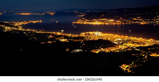 Night view over Messina and Strait of Messina, taken from the top of Colli San Rizzo. Aerial view of the City night from the view point on top of mountain , Messina, Sicily, Italy.
