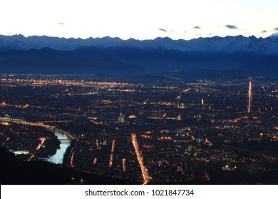 Night view over Turin with illuminated streets and river from Superga.