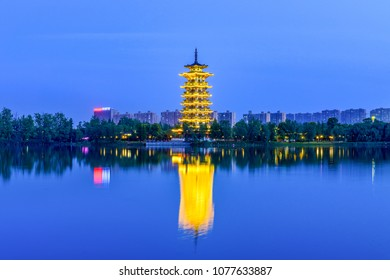 The night view of the pagoda of Changsha Ocean Lake Wetland Park
