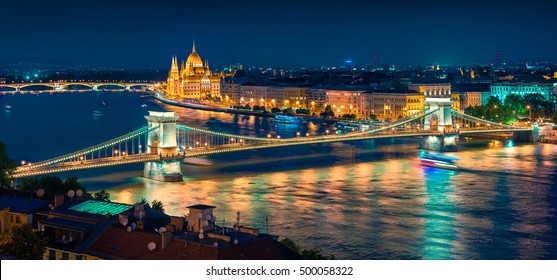 Night view of Parliament and Chain Bridge in Pest city. Colorful evening cityscape of Budapest, Hungary, Europe. Artistic style post processed photo.