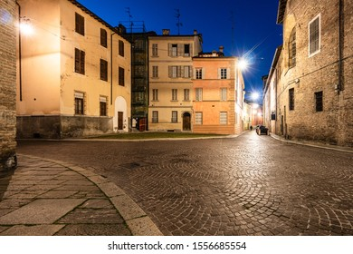 Night view of Parma old town house and cobblestone street in Itlay