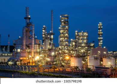 Night view of petrochemical plants and oil refineries, natural gas tanks with a blue background