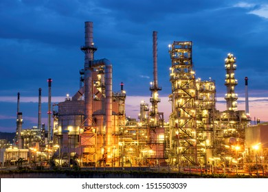 Night view of petrochemical plants and oil refineries, natural gas tanks with a blue sunrise background