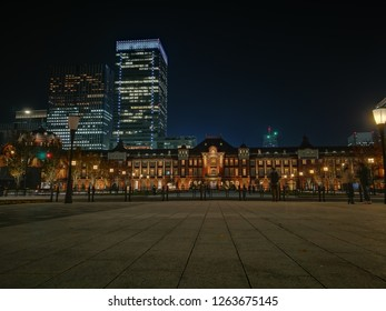 Night view point at park in front of Tokyo Station, Japan. Ancient and old building architecture. Transportation center in capital city.