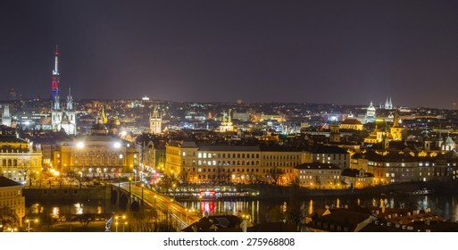 night view of prague including charles bridge, national theatre and old town square town hall taken from the prague castle.