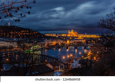 Night view of Prague from Vysehrad with bridges over Vltava river, Prague castle and Petrin hill in the background  in the evening with dramatic clouds. Prague. Czech Republic.