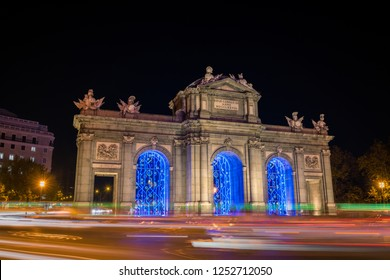 Night view of the Puerta de Alcala in Madrid, decorated for Christmas.