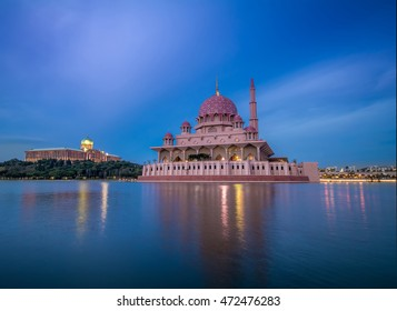 Night view of The Putra Mosque. The Putra Mosque or Masjid Putra in Malay language, is the principal mosque of Putrajaya, Malaysia.