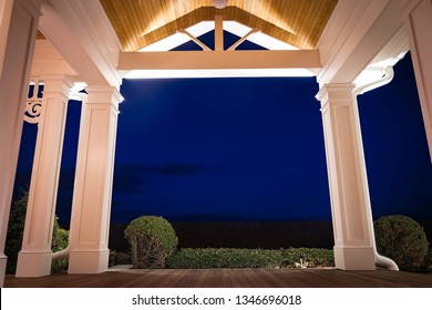 Night view of PVC millwork, pillars, and woodwork on home residence.
