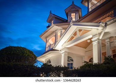 Night view of PVC millwork, pillars, gables, and woodwork on home residence.