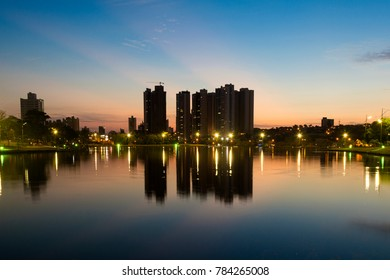 Night view and reflection of buildings in the lake of the park of Nations, City of Campo Grande, Brazil