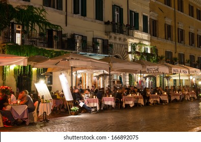 Night view of restaurants on Piazza Navona in Rome, Italy