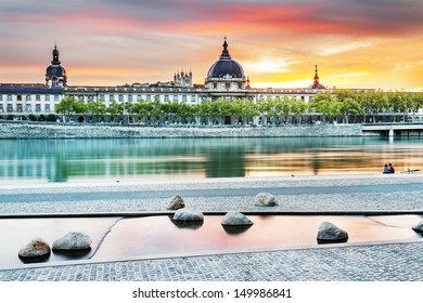night view from Rhone river in Lyon city with Hotel Dieu and Fourviere cathedral, France