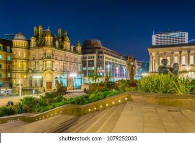 Night view of the river fountain in front of the Victoria square in Birmingham, England