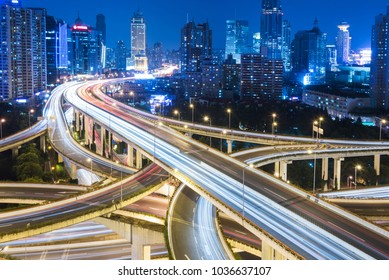 night view of rush-hour traffic in Nanpu overpass,elevated view,Shanghai,China.