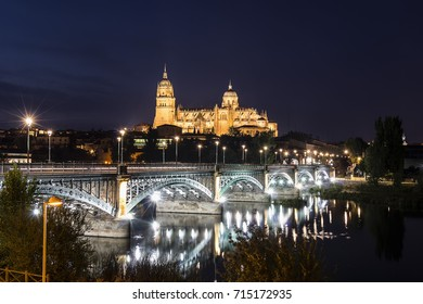 Night view of Salamanca Old and New Cathedrals from Enrique Esteban Bridge over Tormes River, Community of Castile and León, Spain.  Declared a UNESCO World Heritage Site in 1988