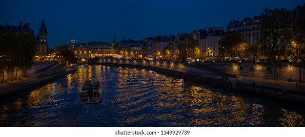 Night view from Seine River in Paris France